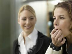 Businesswomen whistling on fingers Stock Photos