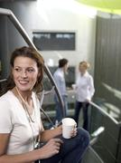 Stock Photo of young woman listening to colleagues talking