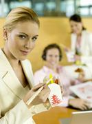 young professionals having luch break in office - stock photo