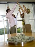 Stock Photo of young professionals in office exercising motivation training