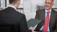 Smiling manager in a job interview Stock Footage