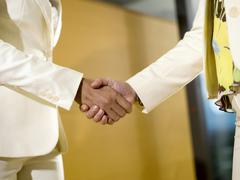 Stock Photo of two women shaking hands