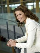 businesswoman leaning on railings, side view, portrait, close-up - stock photo