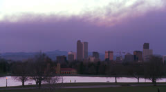 The skyline of Denver Colorado skyline at dusk in purple light. - stock footage