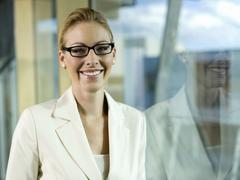 young businesswoman wearing spectacles, portrait - stock photo