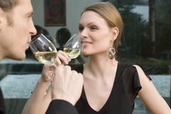Stock Photo of young couple drinking white wine