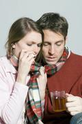 young couple with a cold drinking tea - stock photo