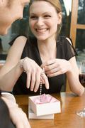 woman rejoicing over jewellery - stock photo