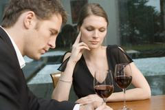 Couple drinking red wine looking unhappy Stock Photos