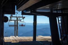 Chairlift Leaving Terminal - stock photo