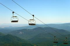 Chairlift and Green Hills Stock Photos