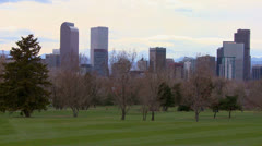 The Denver skyline against the Rocky mountains. - stock footage
