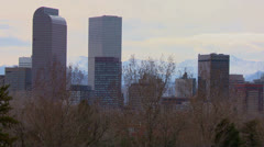 The Denver Colorado skyline in beautiful light with bikers and joggers passing. - stock footage