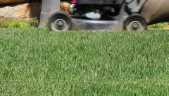 Lawn mower cutting the grass FG Stock Footage