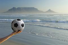 Stock Photo of Africa, South Africa, Kapstadt, Person holding soccer ball, close-up