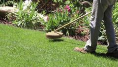 Stock Video Footage of Lawn string trimmer cutting border A