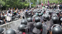 RIOT POLICE SECURITY BARRIER RAZOR WIRE DANGER - stock footage
