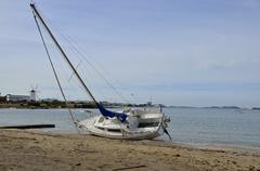 Sailboat aground by temporary Stock Photos