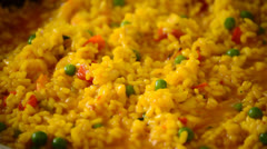Paella rice cooking,  Boil oily pilaf close Stock Footage