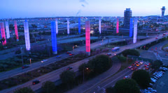 The colorful lights of Los Angeles International airport glow in the dark. - stock footage