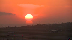 A plane arrives at an airport at sunset or sunrise. Stock Footage