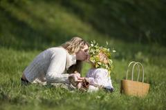 Mother and daughter in meadow, doughter wearing wreath on head Stock Photos