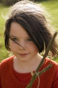 girl (7-9) holding stick, portrait - stock photo