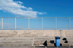 Italy, Sardinia, Cagliari, View of harbour with dustbin on stairs - stock photo