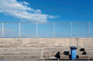 Stock Photo of Italy, Sardinia, Cagliari, View of harbour with dustbin on stairs