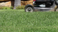 Lawn mower cutting the grass G Stock Footage