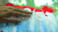 Preparing examining examine feathered headdress Stock Footage