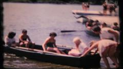 160 - girls go out on the lake in row boat - vintage film home movie Stock Footage