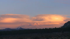 Lenticular clouds in a sunset formation. - stock footage