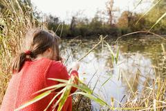 Stock Photo of girl (7-9) fishing
