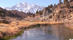 A beautiful river runs through the Sierra Nevada mountains. Stock Footage