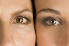 Stock Photo of Mature mother and daughter, heads together, portrait, close-up