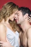 Stock Photo of Young couple embracing, close-up