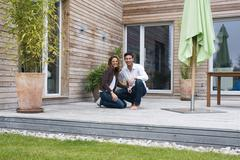 Stock Photo of Germany, Bavaria, Munich, couple on terrace in front of house
