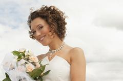 Stock Photo of Germany, Bavaria, Smiling Bride with bouquet, outdoors