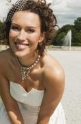 Stock Photo of Germany, Bavaria, Bride in park, smiling, portrait, close-up