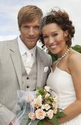 Stock Photo of Germany, Bavaria, Portrait of groom and bride, outdoors, close-up