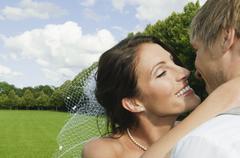 Stock Photo of Germany, Bavaria, Bridal couple kissing outdoors, portrait, close-up