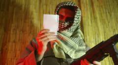 Terrorist reading read orders 2 Stock Footage