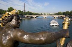 France, Paris, Seine, Pont Alexandre III, sculpture in foreground Stock Photos