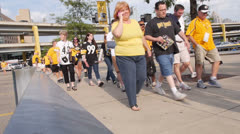 Steelers Fans Walk to Heinz Field Stock Footage