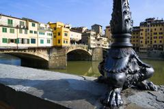 Italy, Florence, Ponte Vecchio, Lamp stand of street light in foreground Stock Photos
