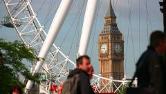 Pedestrians by Big Ben and London Eye 01 Stock Footage