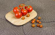 Fancy orange cherry tomatoes and red tomatoes on vine. Stock Photos