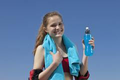 Germany, Bavaria, Teenage girl holding water bottle, portrait Stock Photos