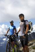 Germany, Bavaria, Karwendel, Couple with mountain bikes, taking a break Stock Photos